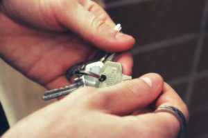 Car and home keys to a newly insured individual. - Risk Averse Insurance
