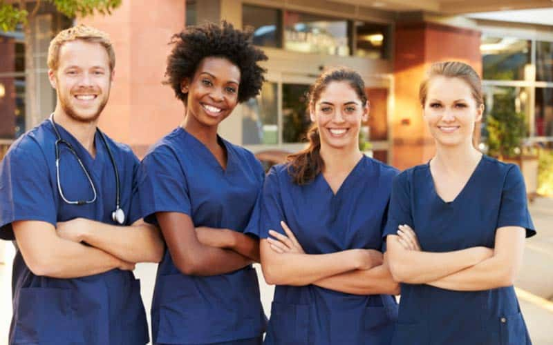 4 nurses eligible for professional liability insurance posed and smiling